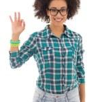 Smiling beautiful african american teenage girl showing ok sign — Stock Photo #73010367