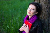 Dreamy beautiful woman with book in summer park — Stock Photo