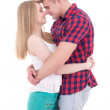 First love concept - young man and woman kissing isolated on whi — Stock Photo #74153417
