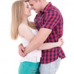 první láska koncept - mladý muž a žena líbat izolované na whi — Stock fotografie #74153417