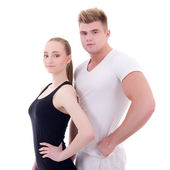 Portrait of young man and woman in sportswear isolated on white — Stockfoto