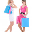Two girls in dresses after shopping isolated on white — Stock Photo #74351331