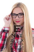 Portrait of blondie woman in eyeglasses with eye test chart — Stock Photo