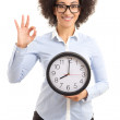 Beautiful african american woman holding office clock and showin — Stock Photo #74465967