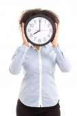 Woman covering face with office clock isolated on white — Stock Photo