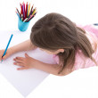 Back view of little girl drawing with colorful pencils isolated — Stock Photo #76473009