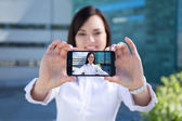 Beautiful woman making selfie photo on smartphone — Stockfoto