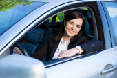 Young business woman sitting in her car — Stock Photo