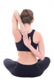 Back view of slim woman sitting in yoga pose isolated on white — Stock fotografie