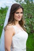 Portrait of beautiful bride walking in garden — Stock Photo