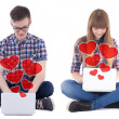 Online dating concept - teenage boy and girl sitting with comput — Stock Photo #78209550