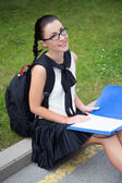 Education concept - beautiful school girl or student reading som — Stock Photo
