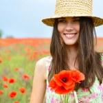 Woman in poppy field — Stock Photo #52015341