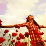Woman in poppy field — Stock Photo #52019195