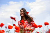 Woman on  poppy field — Stock Photo