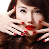 Woman with long hair, red lipstick and manicure — Stock Photo