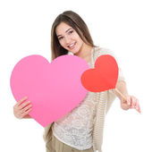 Girl with red and pink hearts — Stock Photo