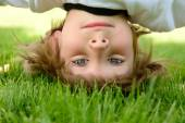 Boy standing upside down — Stock Photo