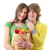 Couple with grocery bag — Stock Photo
