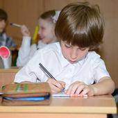 Schoolboy at classroom — Stock Photo