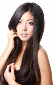Young beautiful girl with long black hair — Stock Photo
