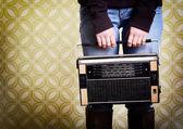 Woman with vintage radio — Stockfoto
