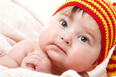 Cute baby  in vivid funny hat — Stock Photo