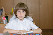 Schoolboy in school — Stock Photo