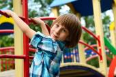 Boy playing on playground — Stock Photo