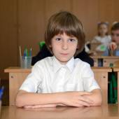 Schoolboy at classroom — Stock Photo