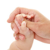 Baby holds mother's hand, — Stock Photo