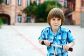 Boy riding  scooter — Stock Photo