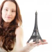 Woman holding Eiffel tower — Stock Photo
