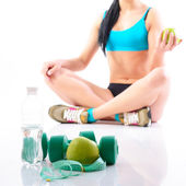 Fitness woman holding  apple — Stock Photo