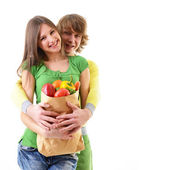 Couple with grocery bag — Stockfoto