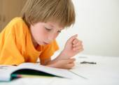 Little boy reading book — Stock Photo
