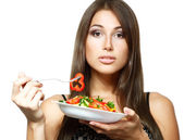 Young woman holding bowl of salad — Stock Photo