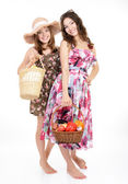 Girls with baskets — Stock Photo