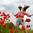 Woman dancing at poppy field, — Stock Photo #52020071