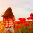 Woman dancing on poppy field — Stock Photo #52020475