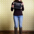 Woman with vintage radio — Stock Photo #52020905