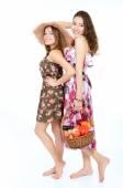 Women holding baskets — Stock Photo