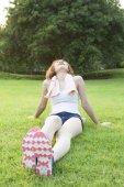 Woman Sitting after jogging. — Zdjęcie stockowe