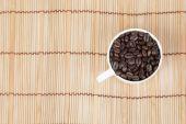 Glass of white coffee beans — ストック写真