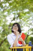 Student carrying books — Stock Photo