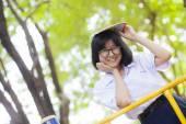 Schoolgirl smiling and happy. — Stock Photo