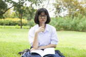 Schoolgirl is sitting homework. — Stock Photo