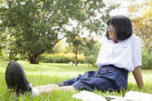 Schoolgirl is sitting and relaxing. — Stock Photo