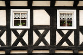 Half-timbered wall with two windows — Stock Photo