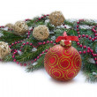 Christmas red ball, twig of fir , red beads — Stock Photo #58186895